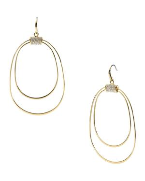 Thin oval earrings with rhinestones